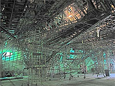 The acoustical ceiling will be suspended from the building's roof with steel cables, and shock absorbers will isolate the internal structure from all external sound.