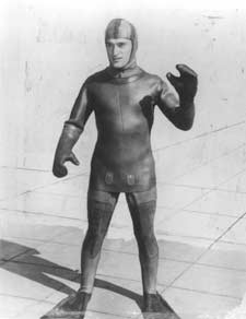 Photo of John S. Foster modeling an early design of the Hugh Bradner wet suit created at Scripps Institution of Oceanography.