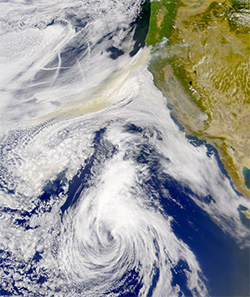 Photo of particulate matter extending over Pacific Ocean