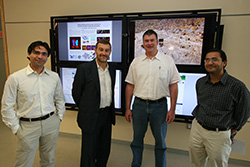 Photo of Nuno Bandeira executive director of the Center for Computational Mass Spectrometry, and Jacobs School of Engineering computer science professors Pavel Pevzner,  Ingolf Krueger and Vineet Bafna