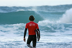 Photo of Surf Team member Chris David hits the waves.