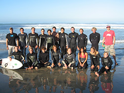 Photo of UC San Diego's nationally ranked Surf Team at Black's Beach.