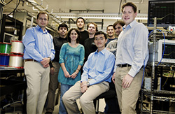 Photo of Professor Stojan Radic with members of  his DARPA-funded photonics team at Calit2 UC San Diego
