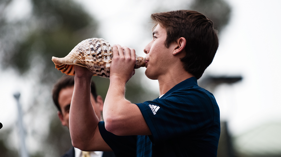 Justin Gordon, a member of UCSD's men's crew team, better known as Mr. Triton around campus, blew a conch during the ceremony.