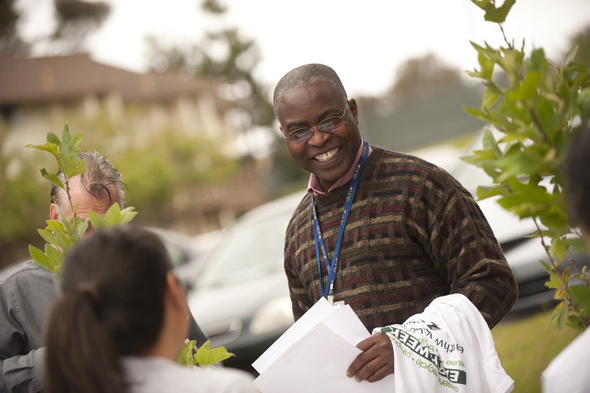 Sam Oludunfe, UCSD's urban forester, greets tree-planting participants.