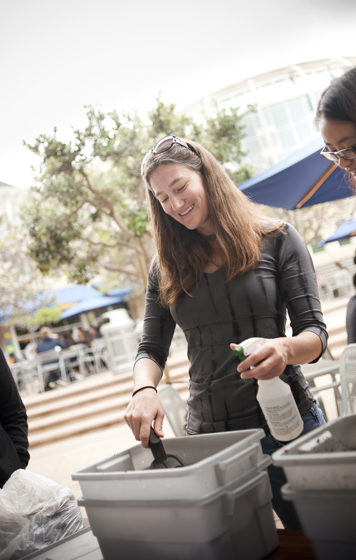 Laura McIntire, a yoga and composting instructor with UCSD Recreation, shows how to put together a small composting bin with worms for your dorm room or office.