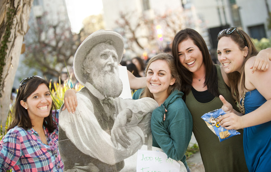 Students pose with a picture of John Muir at Muir College during Muirstock.