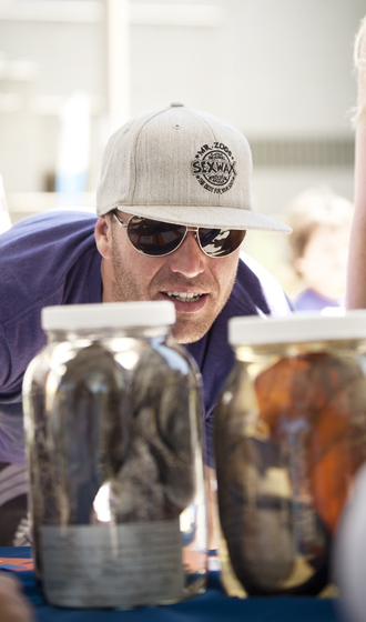 A visitor admires specimens in a Scripps Institution of Oceanography collection.