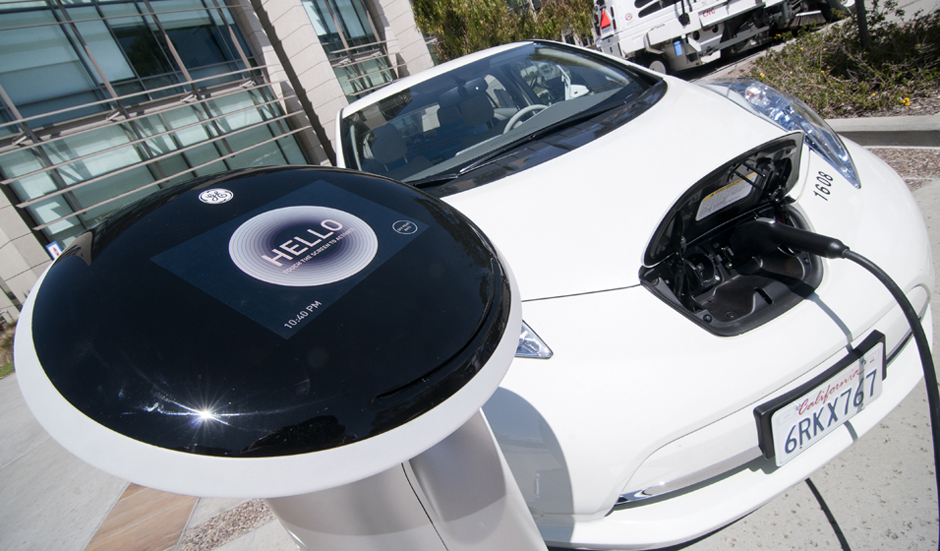 A Sempra Energy electric car charges during the green car show.