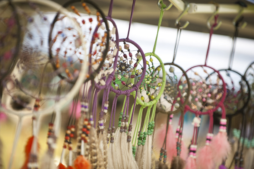 A vendor at the powwow displays dreamcatchers, considered by some as a symbol of unity among many Native Americans.