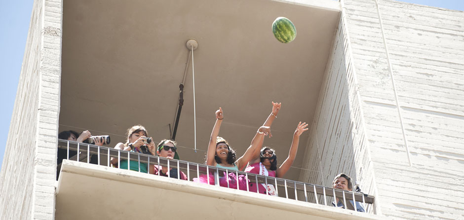 Watermelon Queens Daya Raman and Shilpa Chode throw the watermelon off the 7th floor of Urey Hall.