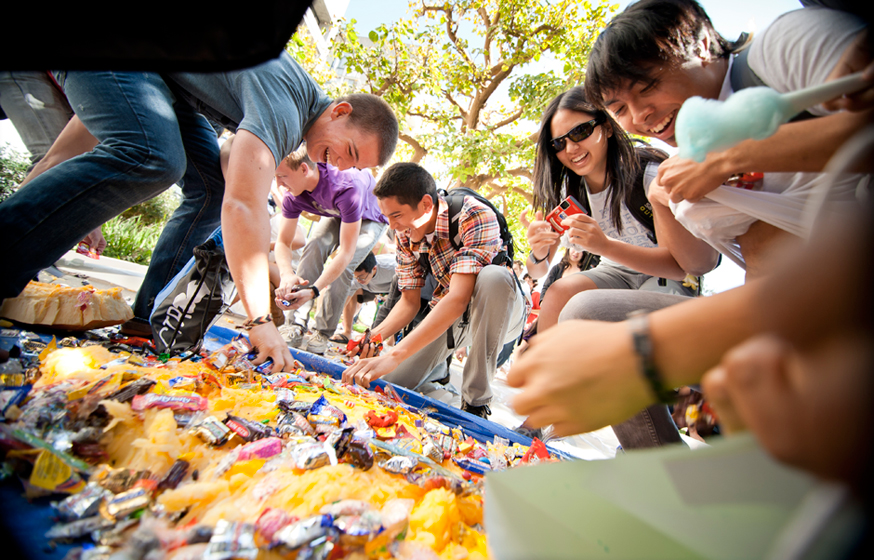 Students collect candy from a giant splattered pumpkin Monday at the 36th Annual Muir College Pumpkin Drop. Photos by Erik Jepsen/UC San Diego Publications
