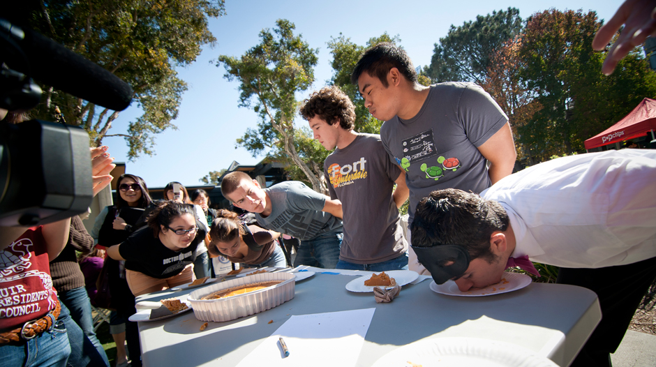 Students compete in a pumpkin pie-eating contest at the Muir Halloween Festival.