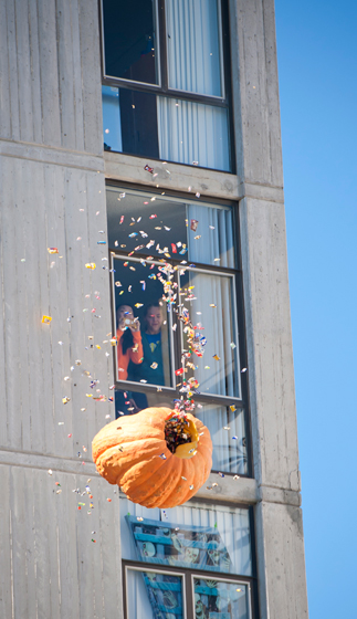 Students dropped a 400-pound candy-filled pumpkin from the 11th story of Tioga Hall, the tallest building on the Muir College campus, on Monday, October 31.