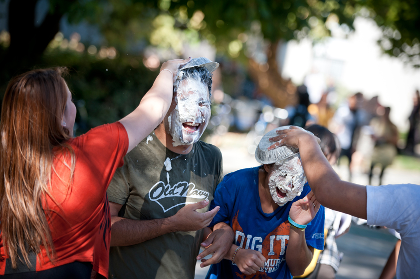 RA's are pied in the face at the Pumpkin drop Halloween Festival.
