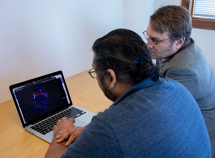 By applying Newtonian physics, Ashay Patel (left) and Michael Burkart (right), along with other researchers, could observe how metabolites behaved in the pocket, resulting in a time-resolved understanding of how proteins interact and catalyze specialized reactions. Photo by Michelle Fredricks, UC San Diego Physical Sciences