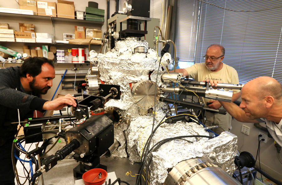 Left to right: Vargas, Monton and Schuller operate an ultra-high vacuum system called Organic Molecular Beam Epitaxy (OMBE) used to growth low dimensional metallic chains. Photo by Michelle Fredricks