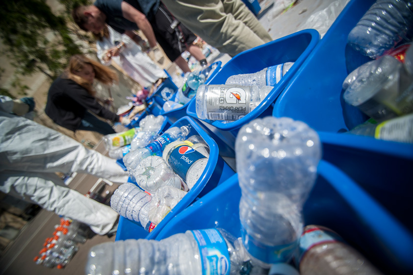 Students recycle water bottles to create an earth bench.