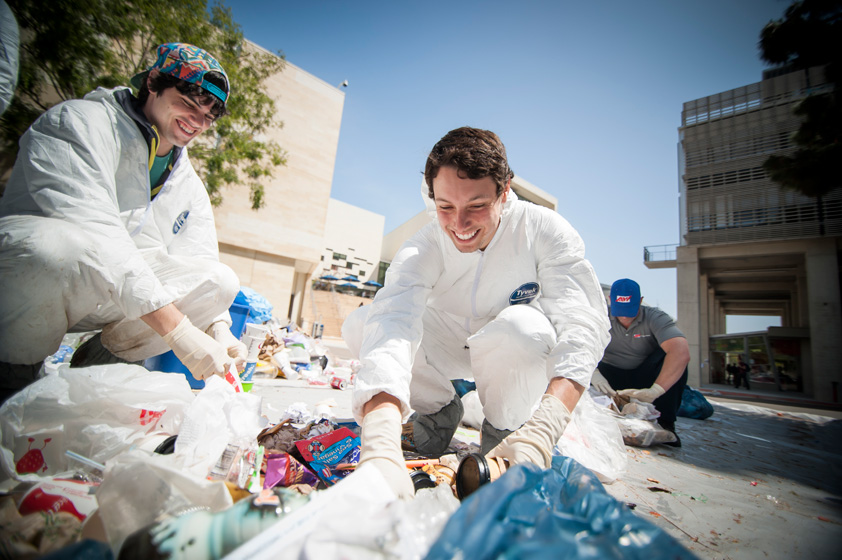 Student volunteers separate trash from recyclables.