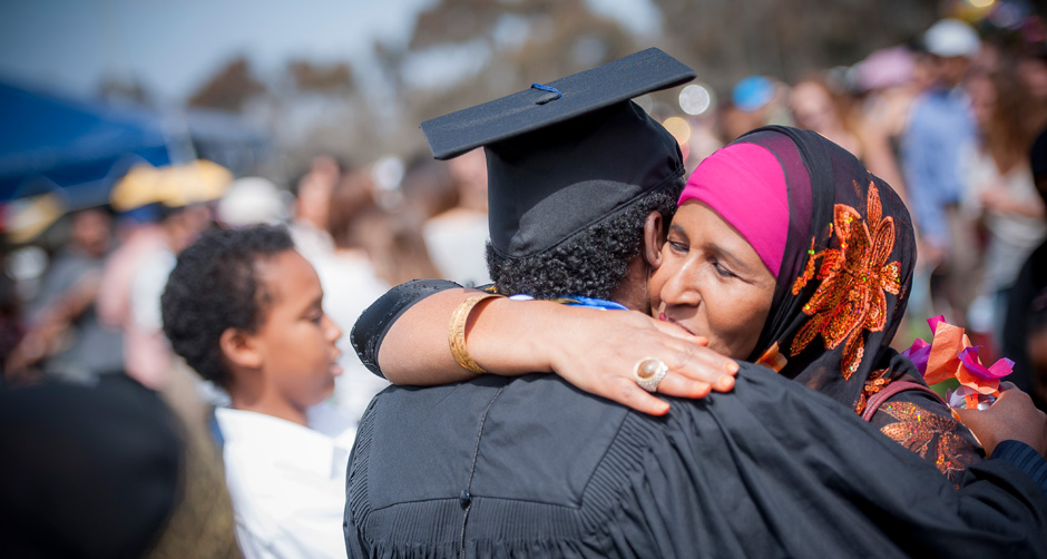 Mohamud Qadi hugs his mom following the Revelle commencement ceremony.
