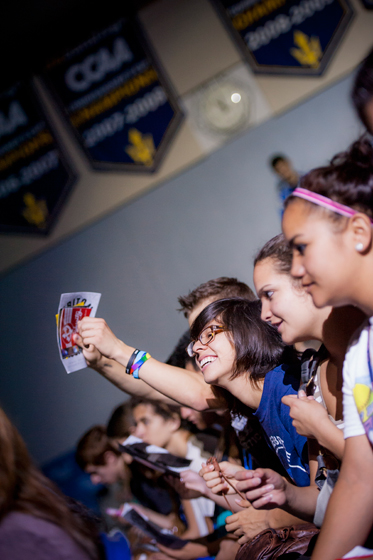 Students cheer for their college during Triton Power Hour.