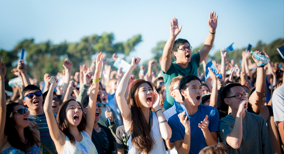 Marshall College students cheer during the opening of the Welcome Convocation commencement on RIMAC Field.