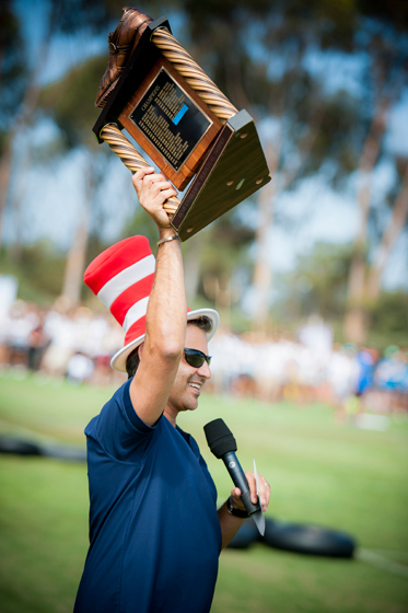 Alumni Association Executive Director Armin Afsahi holds up the Golden Shoe before the start of the 30th Annual UnOlympics.