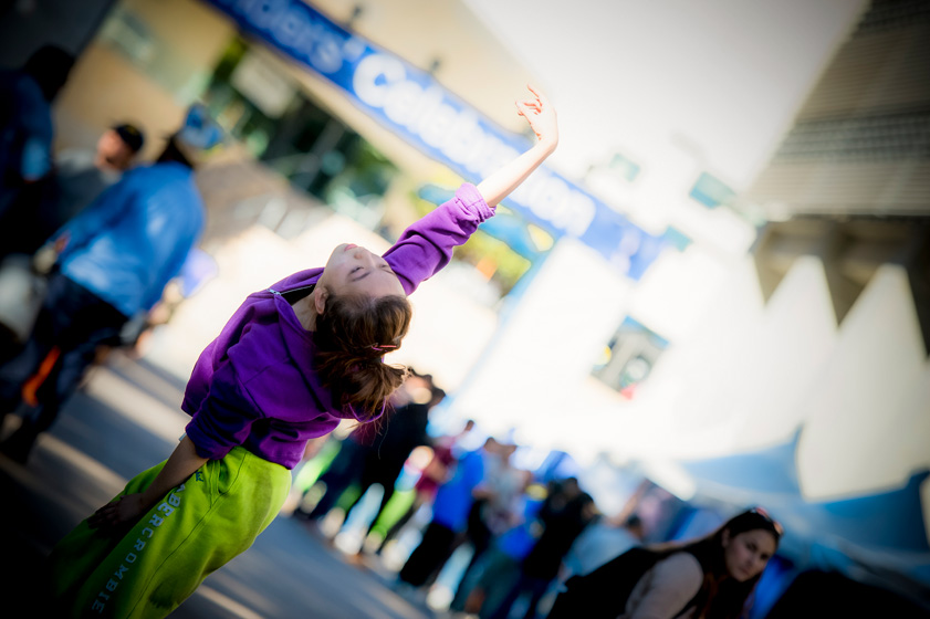 A dancer performs in Town Square for the Division of Arts and Humanities booth.