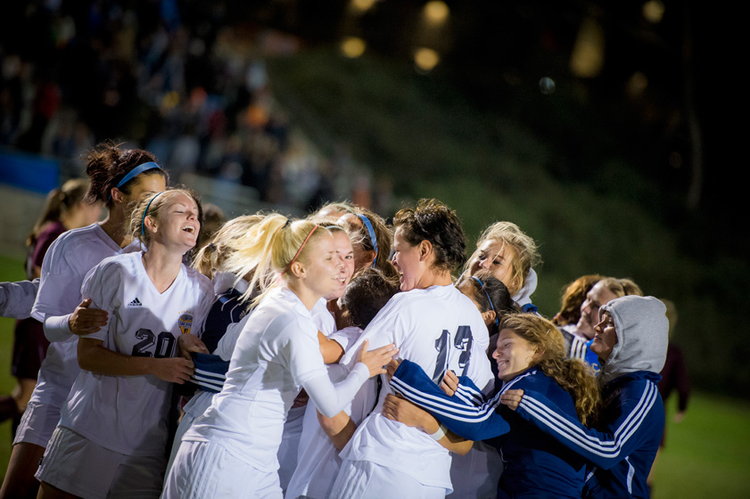 Senior Jessica Wi is hugged by teammates after her goal at 103:17 of double overtime pushed UC San Diego past Seattle Pacific, 2-1, in an NCAA Division II Women's Soccer Championship Second Round match at Triton Soccer Stadium. The UC San Diego women's soccer team won its eighth CCAA championship in 13 years and finished second at the NCAA championships in Georgia. <br><br>Photos by Erik Jepsen/UC San Diego Publications