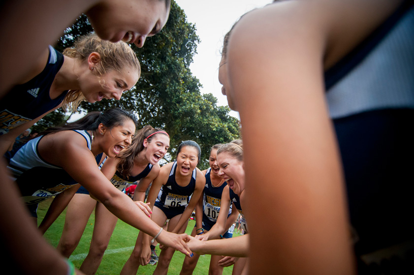Junior Chia Chang (No. 06), center, chants with teammates before the 2012 CCAA Cross Country Championships. Chang was the leader of a young UC San Diego women's cross-country team.