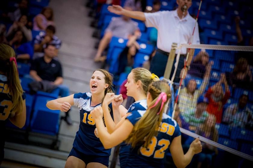 Freshman Sophie Rowe celebrates with teammates after scoring a kill against Sonoma State. Rowe recorded a double-double with a match-high 18 kills and 10 digs.