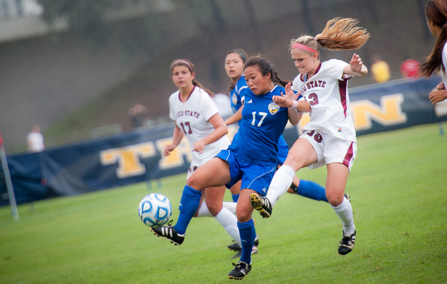Senior Jessica Wi drives the ball downfield against Chico State on Senior Day at Triton Soccer Stadium.