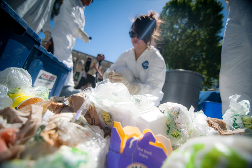"Students and staff sorted through more than 1,000 pounds of trash on Library Walk as part of  Earth Week's ""Reduce your Waistline"" Trash Sort­­."