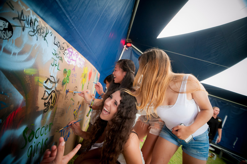 Festival participants paint at Red Bull lounge.