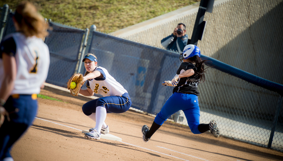 Nicole Spangler, above, and Caitlin Brown of the UC San Diego softball team were named to the Daktronics All-West Region Second Team.