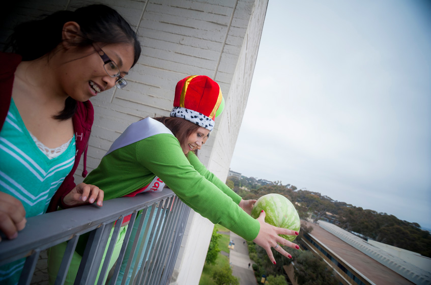 "The event took place Friday, before finals week when this year's  ""Watermelon Queen"" Justine Hopkins, a second-year theatre major,  raced up seven stories of Urey Hall to drop the sacrificial fruit into history."