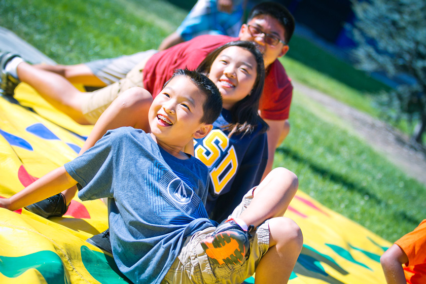 Throughout the day families could be seen striking yoga-like positions, falling over and laughing while playing a giant game of Twister on the lawn during Family Fest in Town Square.