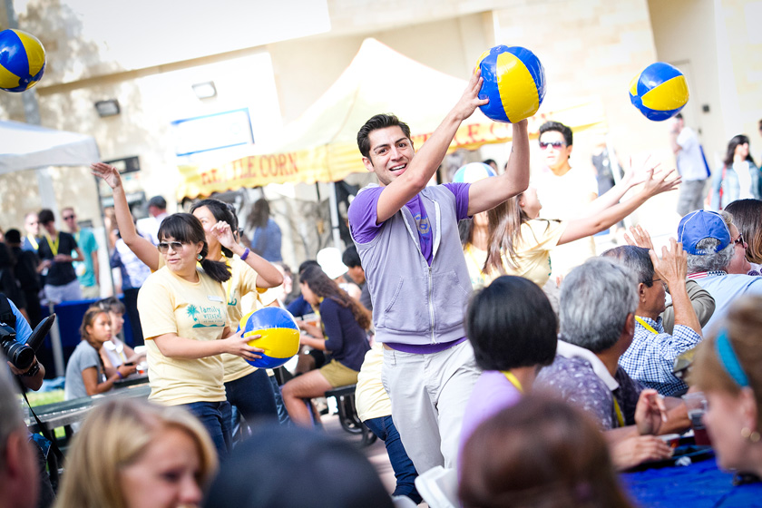 A beach ball flash mob entertained families as they ate lunch in Town Square, dancing to the music and tossing the balls to each other across the tables.