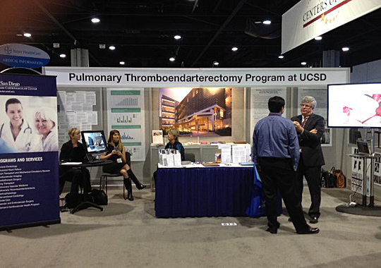<p>Dr. Bill Auger speaks with a colleague at the 2012 CHEST conference, hosted by AACP in Atlanta.</p>