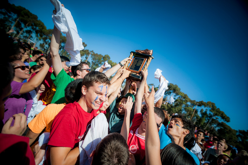 Warren College holds up the coveted Golden Shoe upon winning the UnOlympics.