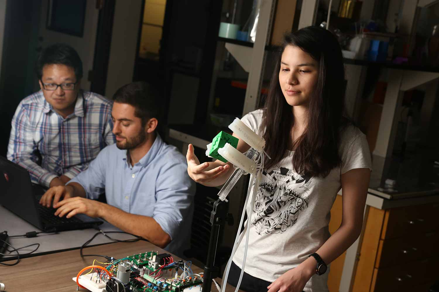 Image: Ph.D. students Benjamin Shih, Dylan Drotman and student Adriane Minori