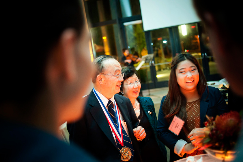 National Medal of Science winner Shu Chien chats with students at the post-symposium buffet.