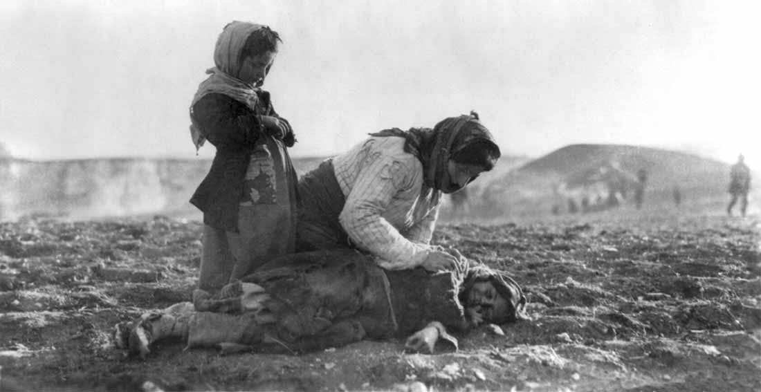 Image: Armenian woman kneeling beside dead children in field