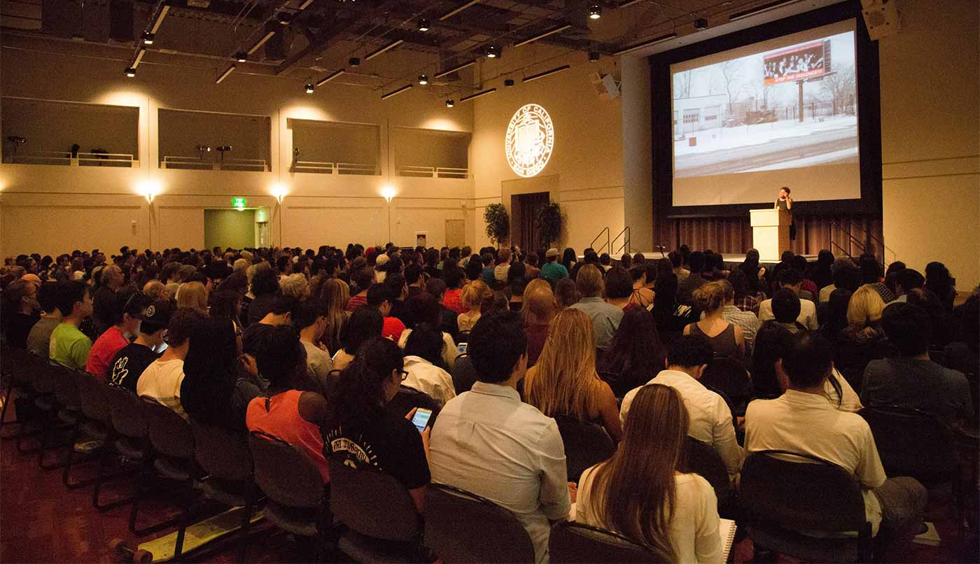 Image: An attentive audience listens to alumna Carrie Mae Weems
