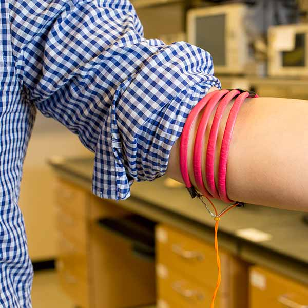 Image: Magnetic-field-generating coils are wrapped around the arm.