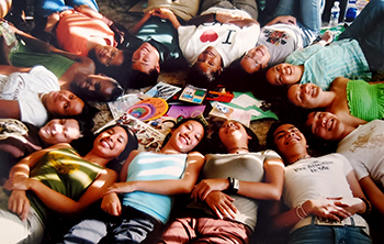 UC San Diego students lying on the floor in a circle at the Cross-Cultural Center