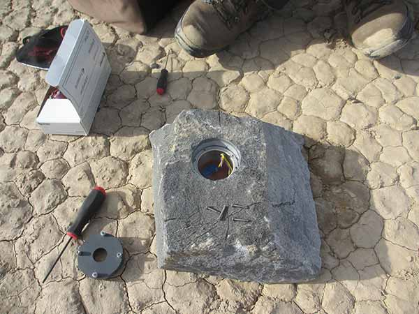 rock with the cavity that held the GPS instrument package and its battery pack
