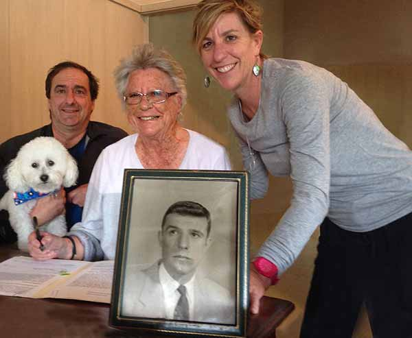 Image: Betty Beyster signing the deed of gift with her children, Jim and Mary Ann Beyster