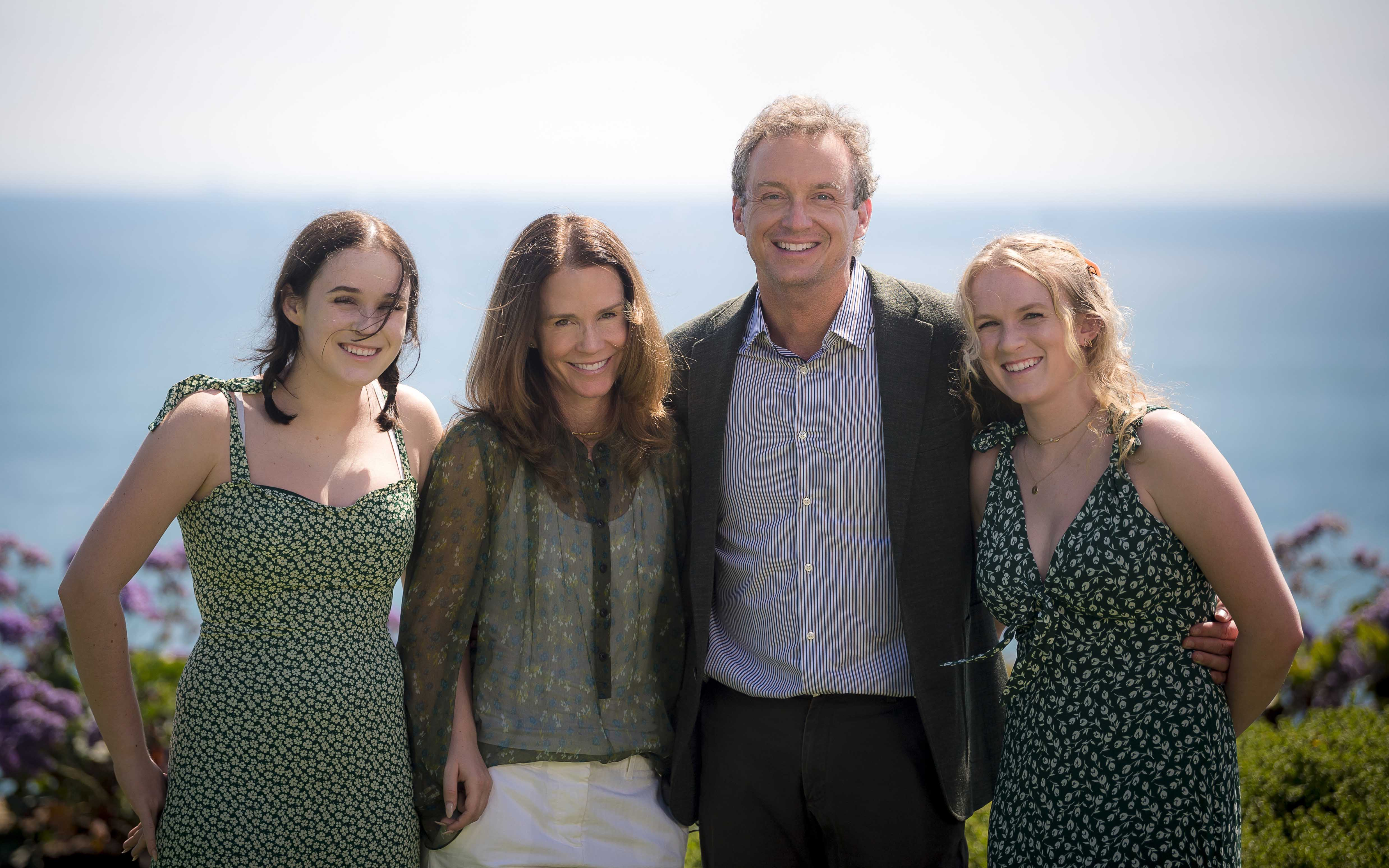 Photo of Sally and John Hood with their two daughters.