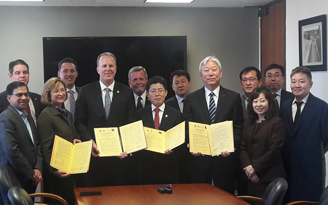 Leaders from the City of San Diego, UC San Diego, Ulsan and UNIST sign a Memorandum of Understanding for the collaborative Smart Transportation Innovation Program.